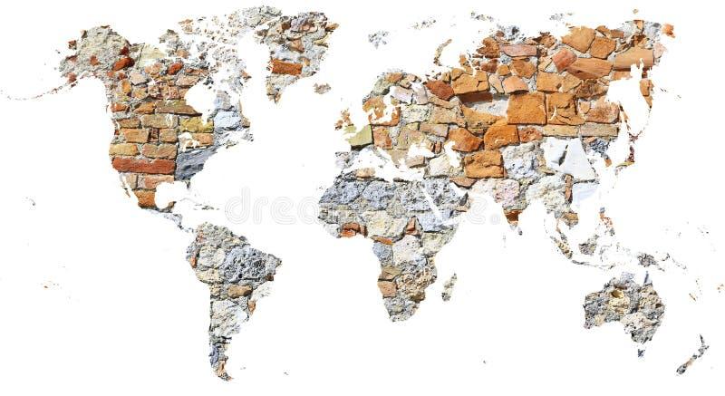 O mapa do mundo cortou na parede antiga feita dos tijolos e das pedras foto de stock royalty free