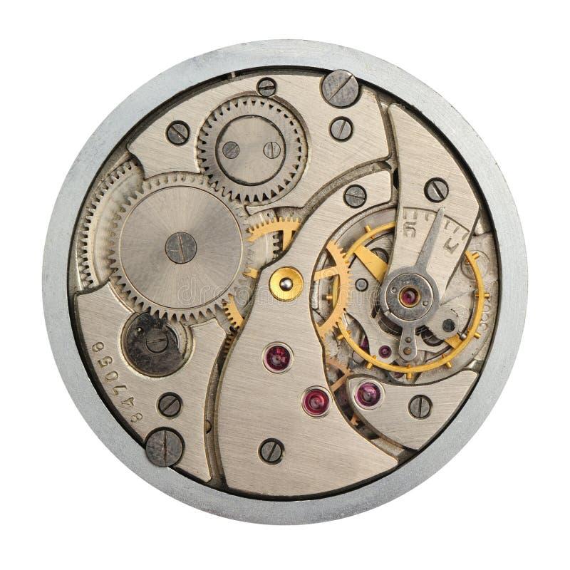 O mecanismo de horas análogas foto de stock
