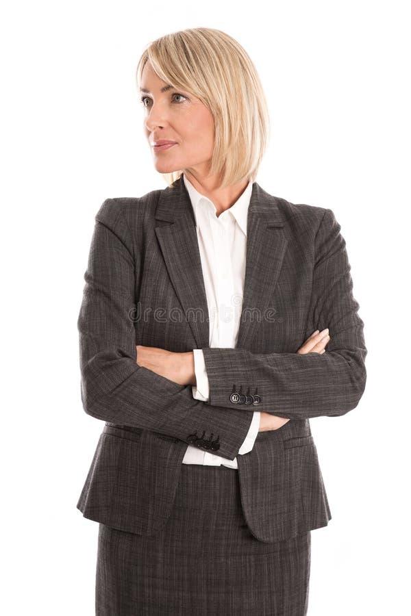 O meio atrativo envelheceu a mulher de negócios que olha lateralmente para text imagens de stock royalty free
