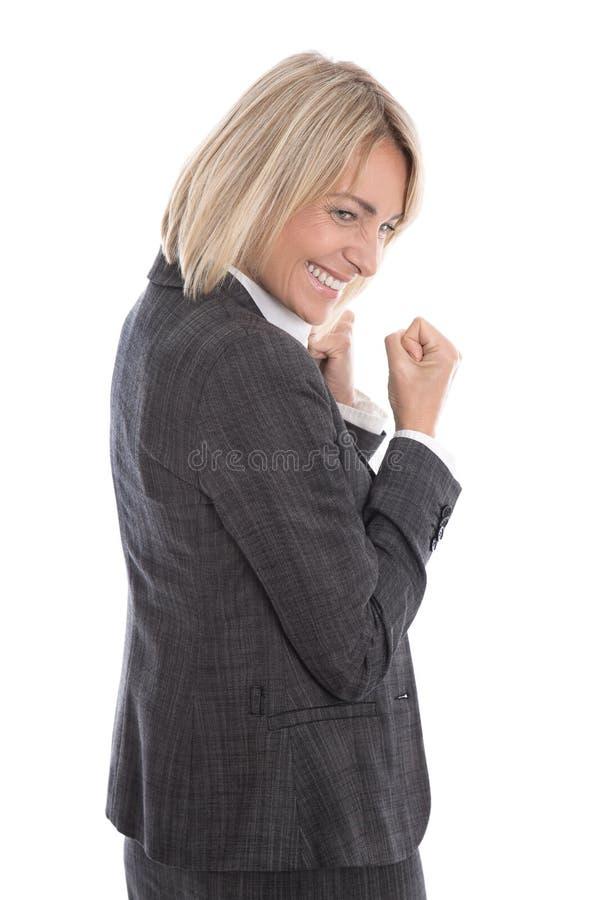 O meio cheering bem sucedido envelhecido isolou a mulher de negócio sobre o whi foto de stock