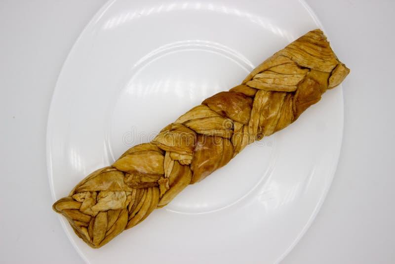 O mel?o secado Uzbeque tran?ou em uma tran?a fotografia de stock