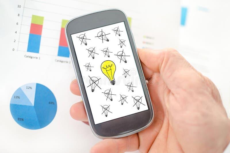 O melhor conceito da ideia em um smartphone ilustração stock