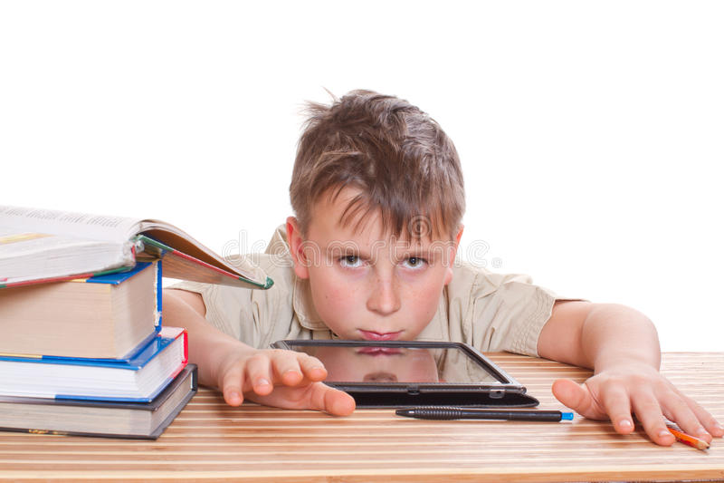 O menino aprende lições imagem de stock royalty free