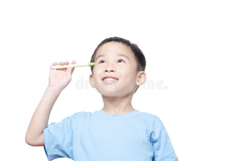 O menino asiático do estudante tem a ideia imagens de stock royalty free