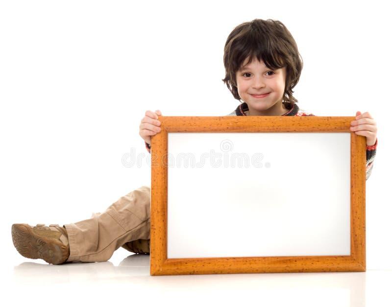 O menino com um frame foto de stock