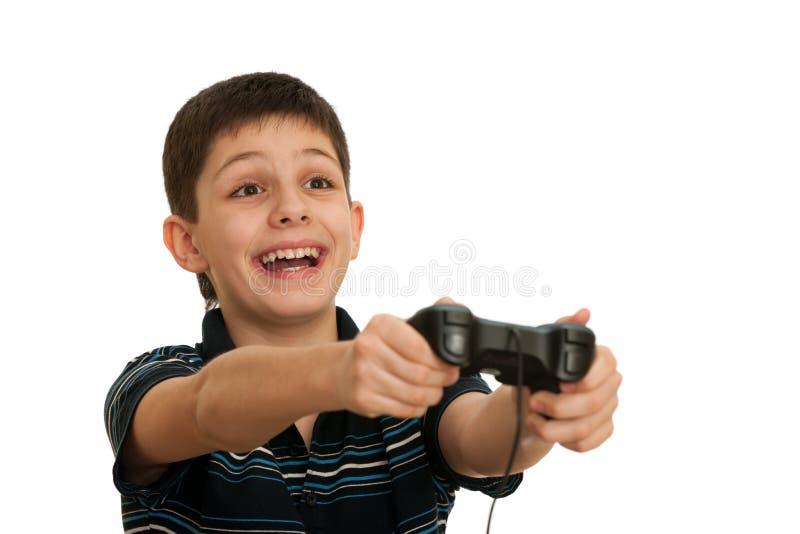 O menino do Ardor está jogando um jogo de computador com manche fotos de stock