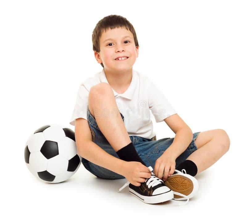 O menino do futebol com estúdio da bola isolou o fundo branco foto de stock royalty free