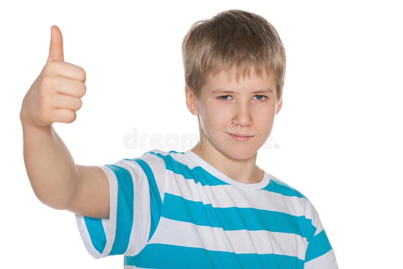 O menino do Preteen mantém seu polegar foto de stock royalty free