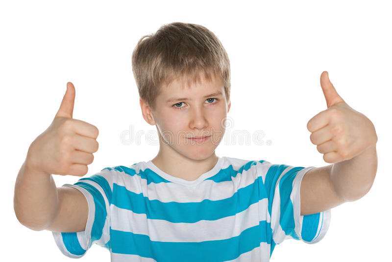 O menino do Preteen mantém seus polegares fotos de stock