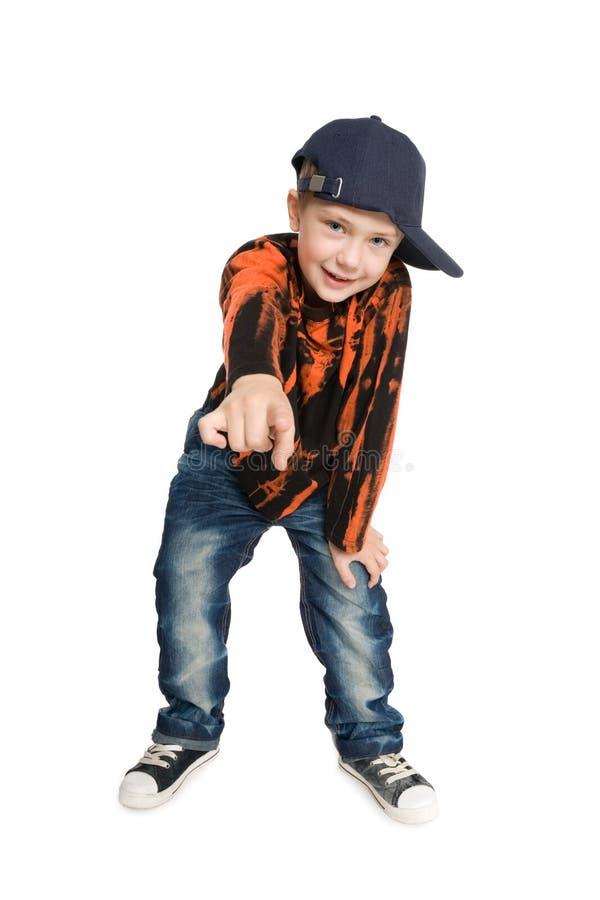 O menino do retrato mostra seu indicador imagens de stock