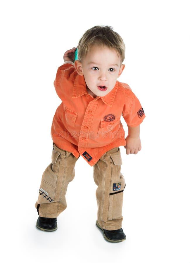 O menino e um brinquedo foto de stock royalty free