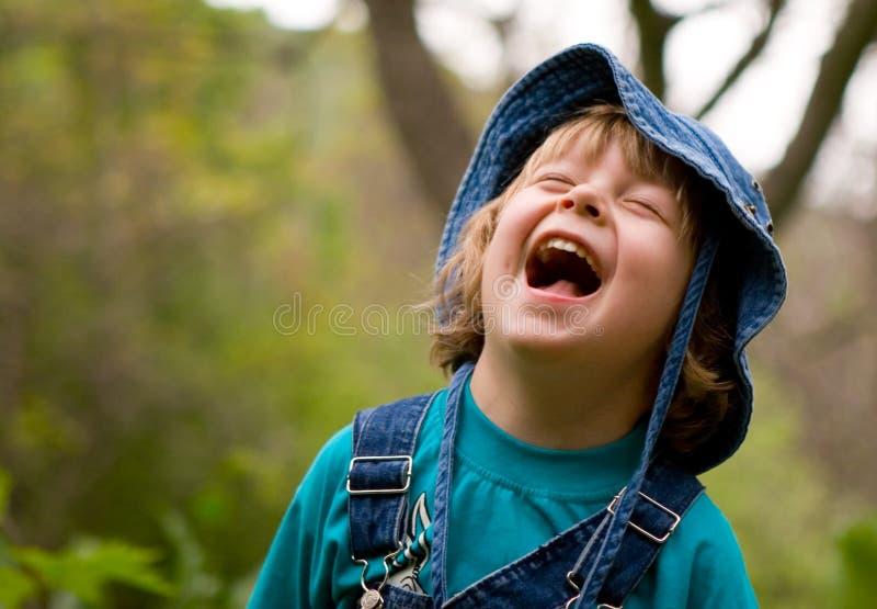 O menino louro está rindo fotografia de stock royalty free