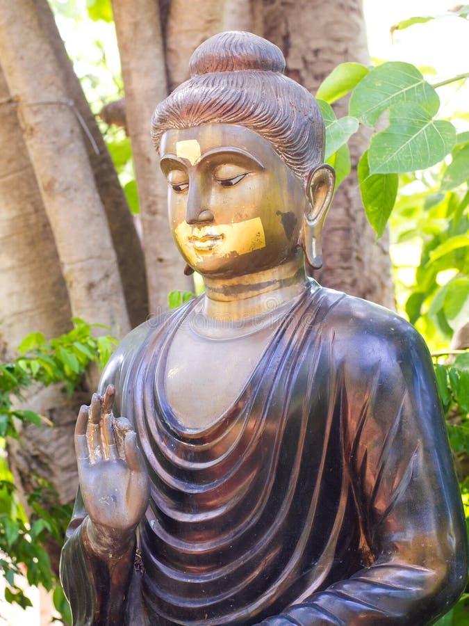 O metal da Buda lá é uma boca dourada Koan imagens de stock