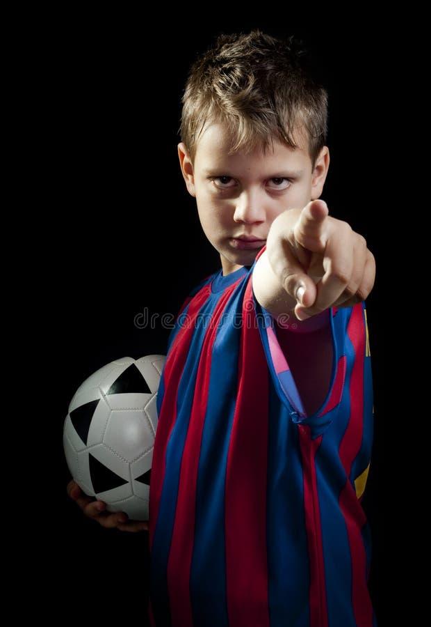 O miúdo do futebol quê-lo fotos de stock royalty free