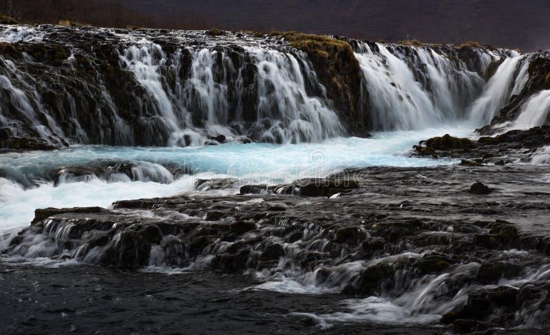 O mistério da cachoeira azul, Bruarfoss fotos de stock royalty free