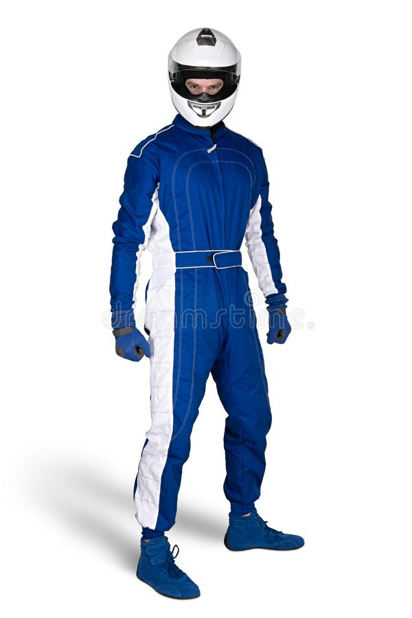 O motorista de raça determinado em luvas totais das sapatas do motorsport branco azul e o capacete de impacto integral da seguran imagens de stock royalty free
