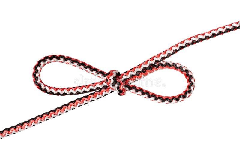 O nó do tolo de Tom amarrado na corda sintética cortada imagens de stock