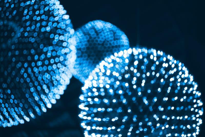 O núcleo, os átomos, os elementos ou as moléculas iluminam a ciência fotografia de stock