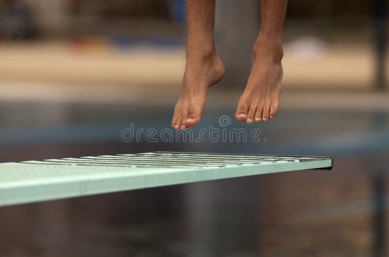 O nadador lanç na água foto de stock royalty free