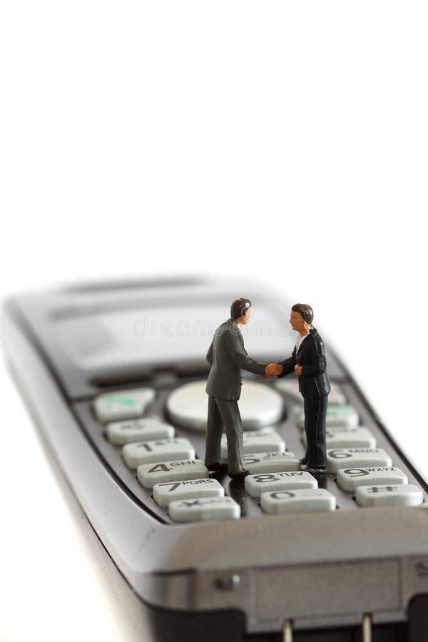O negócio modelo figura o telefone C fotos de stock royalty free