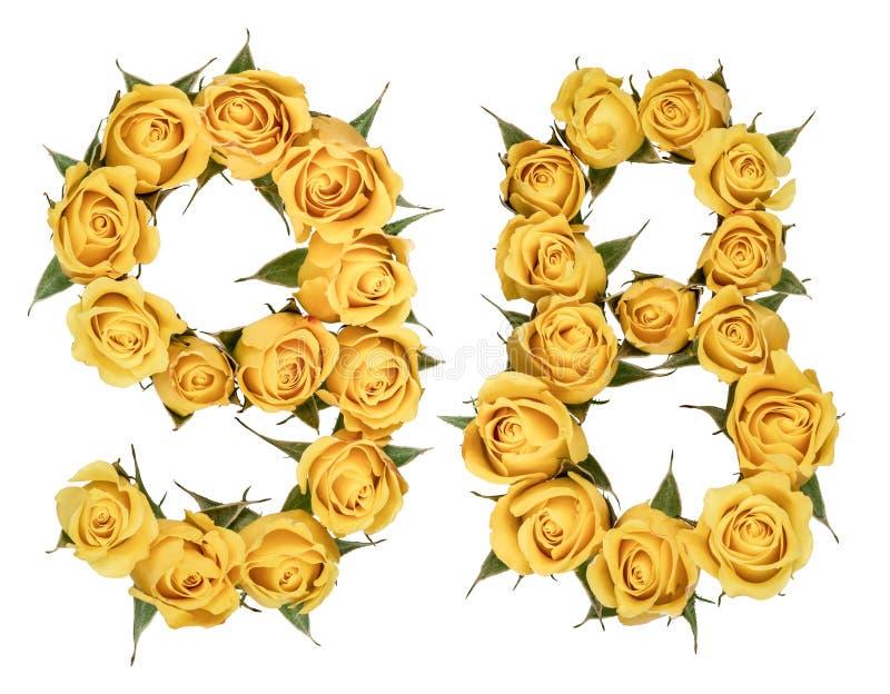 O numeral árabe 98, noventa e oito, das flores amarelas da rosa, é foto de stock