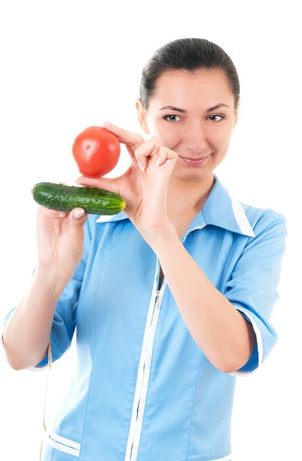 O Nutritionist recomenda vegetais imagens de stock royalty free