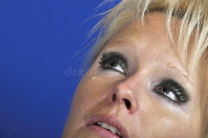 O olho da mulher com rasgo fotografia de stock royalty free