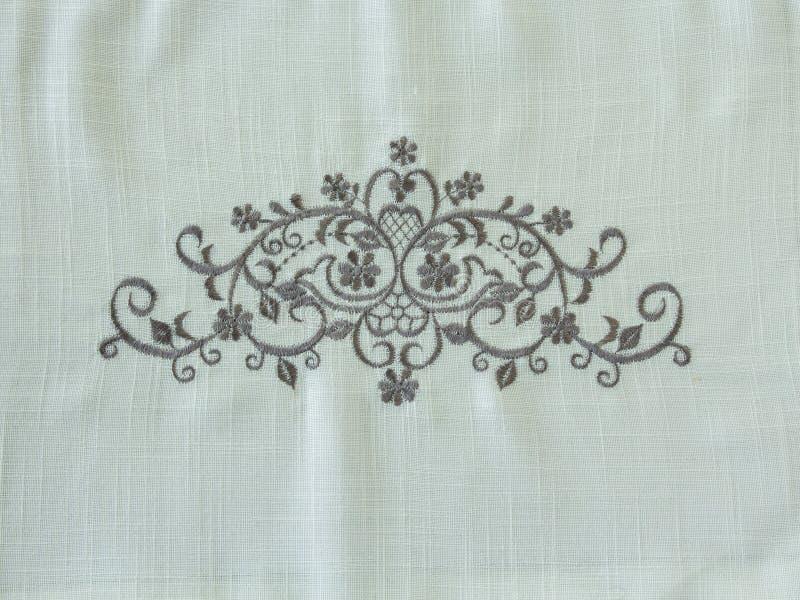 O Ornamental floresce o fundo na tela de linho branca fotografia de stock