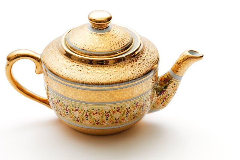 O ouro ornamentado decorou o teapot imagens de stock