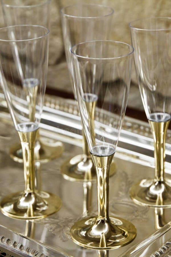 O ouro proveio vidros do champanhe fotos de stock