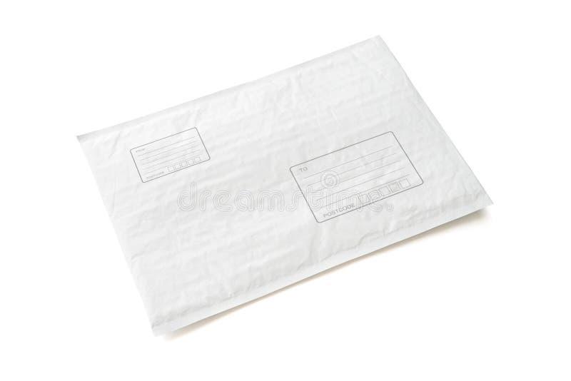 O pacote postal branco com área para escreve o endereço Fundo plástico do objeto do pacote para a propaganda de compra em linha i imagem de stock