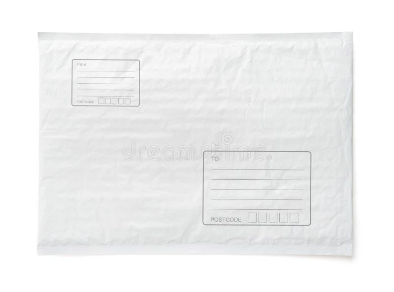 O pacote postal branco com área para escreve o endereço Fundo plástico do objeto do pacote para a propaganda de compra em linha i imagem de stock royalty free
