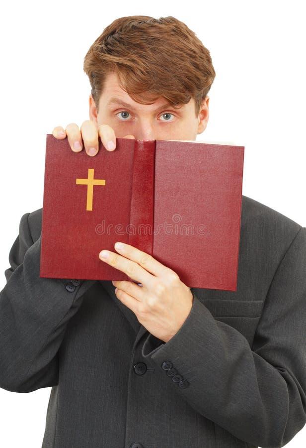O padre defende as escrituras imagem de stock royalty free