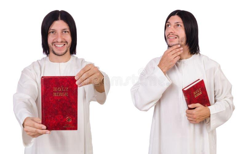 O padre novo com a Bíblia isolada no branco foto de stock royalty free