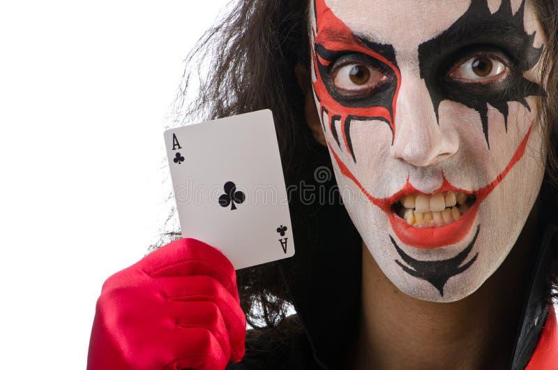 O palhaço com cartões isolou-se fotografia de stock royalty free