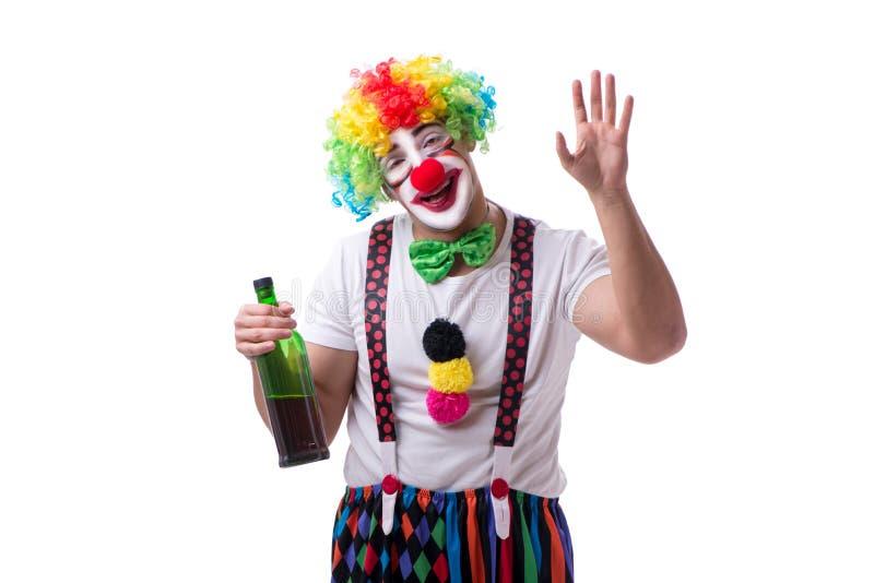 O palhaço engraçado com uma garrafa isolada no fundo branco fotos de stock royalty free