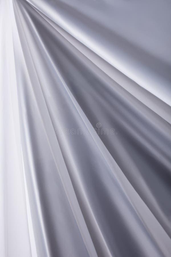 O pano de seda branco acena o close-up da textura do fundo imagem de stock