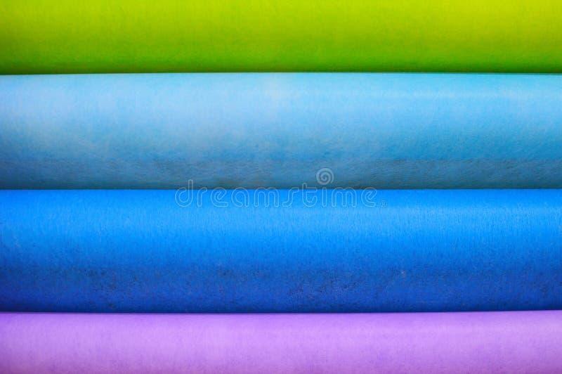 o pano Multi-colorido sentiu o fundo imagens de stock