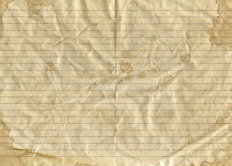 O papel amarrotado marrom do vintage velho em uma régua com espirra e borra fotografia de stock royalty free
