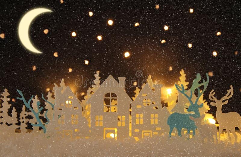 O papel mágico do Natal cortou a paisagem do fundo do inverno com casas, árvores, cervos e neve na frente do fundo estrelado do c ilustração stock