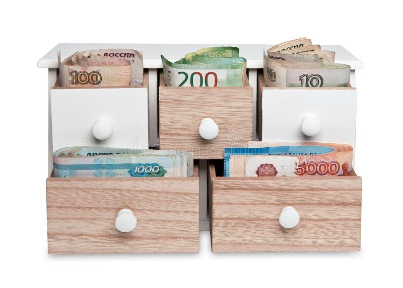 O papel moeda do russo é espalhado para fora em pilhas diferentes foto de stock royalty free