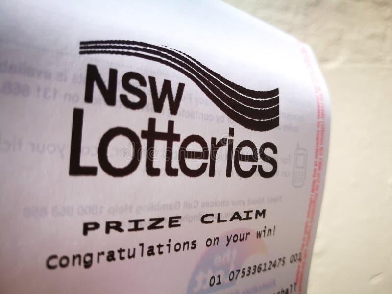 O papel premiado da reivindicação das loterias de Novo Gales do Sul diz felicitações em sua vitória no Livro Branco foto de stock royalty free