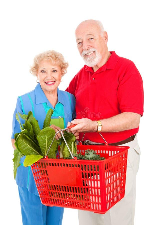 O par sênior compra saudável fotografia de stock