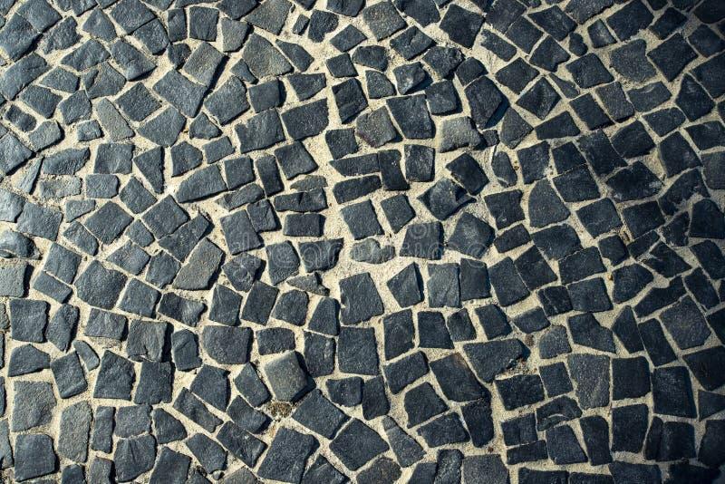O pavimento famoso do passeio da praia de Copacabana em Rio de janeiro, Brasil Textura abstrata da decoração das ruas do Braz imagens de stock royalty free