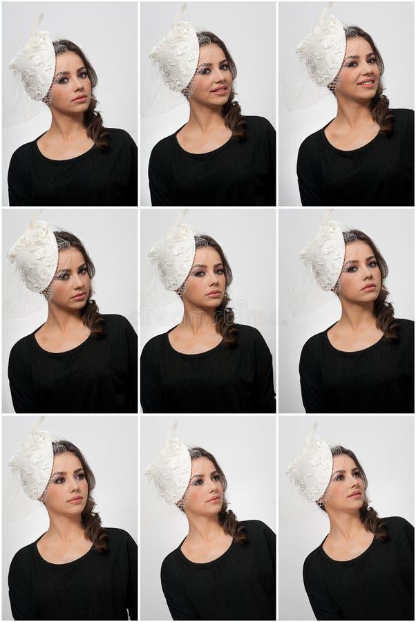 O penteado e compõe - o retrato bonito da arte da moça Morena bonito com tampão e o véu brancos, tiro do estúdio Fêmea atrativa fotografia de stock