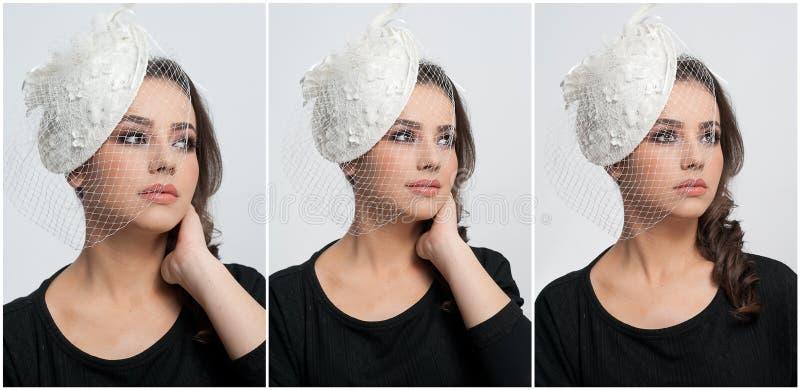 O penteado e compõe - o retrato bonito da arte da moça Morena bonito com tampão e o véu brancos, tiro do estúdio Fêmea atrativa imagens de stock royalty free