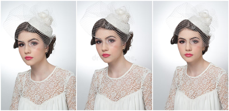O penteado e compõe - o retrato bonito da arte da moça Morena bonito com tampão e o véu brancos, tiro do estúdio Menina atrativa fotos de stock
