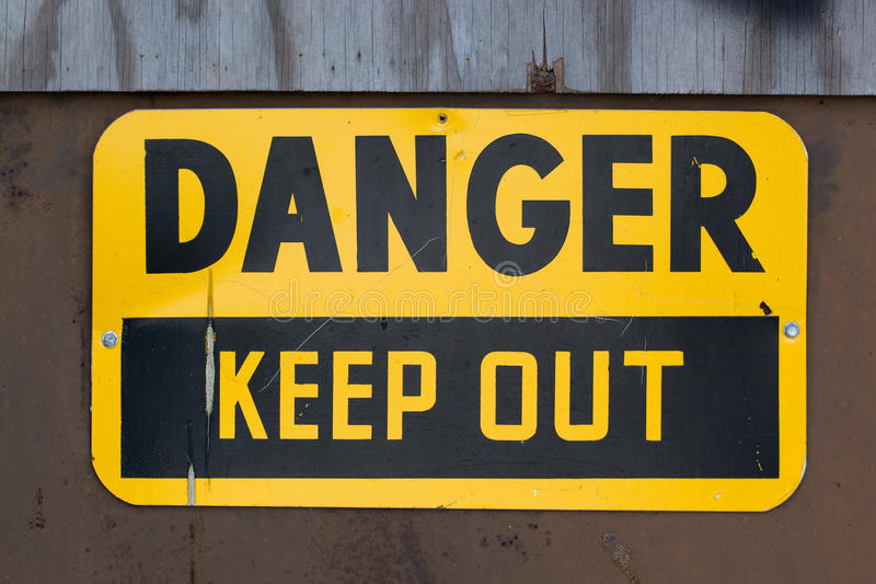 O perigo mantem para fora o sinal foto de stock