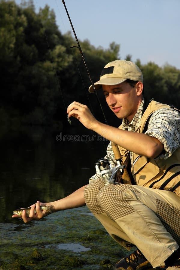 O pescador apenas travou um peixe imagem de stock