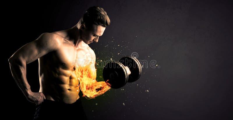 O peso de levantamento do atleta do halterofilista com fogo explode o conceito do braço fotografia de stock royalty free